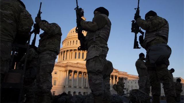 Armed guards in front of the United States Capitol