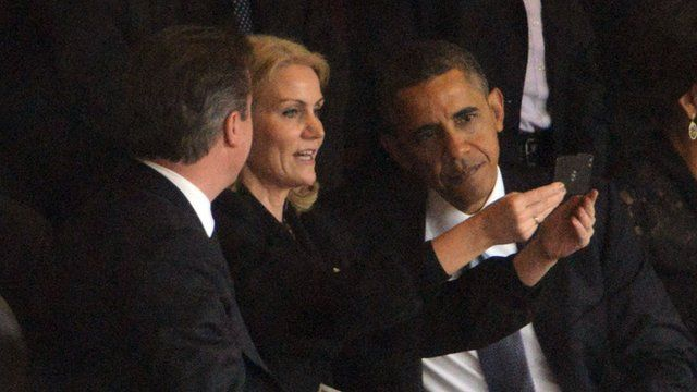 Danish Prime Minister Helle Thorning Schmidt takes a selfie with Barack Obama and David Cameron
