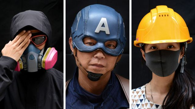 Protesters pose for a portrait during the Anti-Totalitarianism march in Causeway Bay, Hong Kong, 29 September 2019
