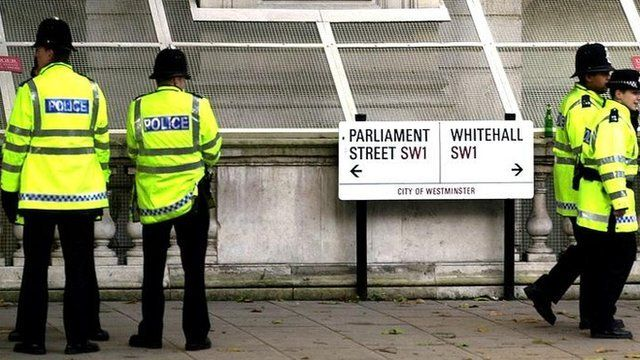 Police patrol around Parliament and Downing Street