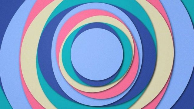 A series of circles in different colours such as purple, indigo, green, cream and pink