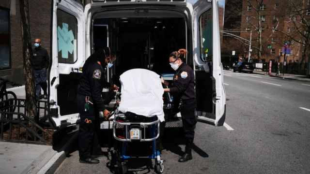 Ambulance workers clean a gurney at Mount Sinai Hospital amid the coronavirus pandemic on April 01, 2020 in New York City