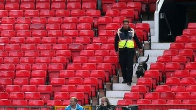 A sniffer dog patrols the stands at prior to match being abandoned with fans evacuated from the ground prior match between Manchester United and AFC Bournemouth at Old Trafford