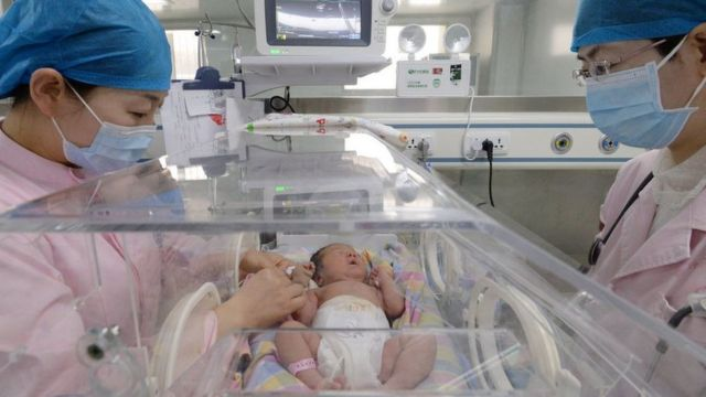 Nurses take care of newborns in an incubator in a hospital in Handan in north China's Hebei province Friday, May 01, 2020.