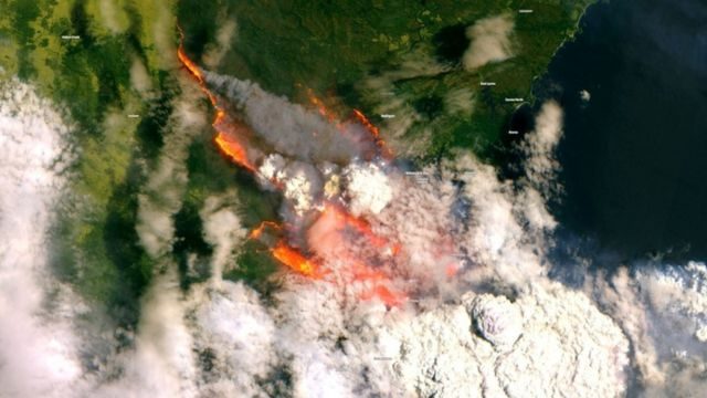 A satellite image of Batemans Bay, NSW, shows smoke and fire from wild bushfires