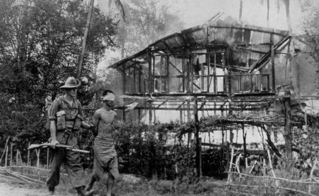Caption:A British soldier with a Japanese sniper he captured near Pegu, Burma (Jan 1945)