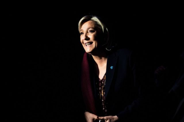 Marine Le Pen smiles as she attends a two-day political rally to kick off her presidential campaign in Lyon, 4 February