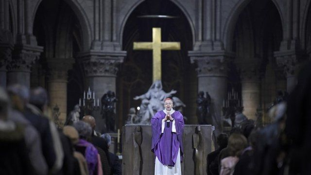 The Archbishop of Paris, Andre Vingt-Trois says mass at the Notre Dame Cathedral in Paris