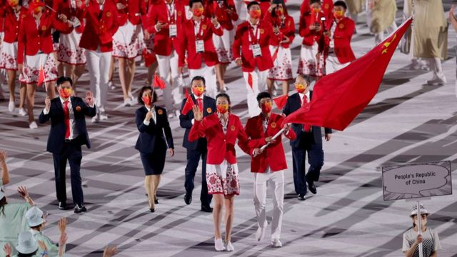 Flag bearers Ting Zhu and Shuai Zhao of Team China lead their team out during the Opening Ceremony of the Tokyo 2020 Olympic Games at Olympic Stadium on July 23, 2021 in Tokyo, Japan.