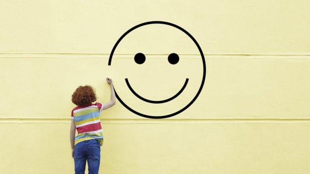Child draws a happy face