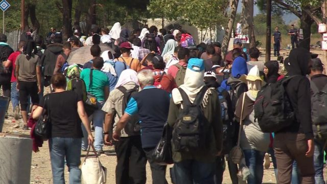 People walking near the the Greece-Macedonia border