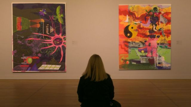 A woman views contemporary pop art is on display at the Montreal Museum of Fine Arts