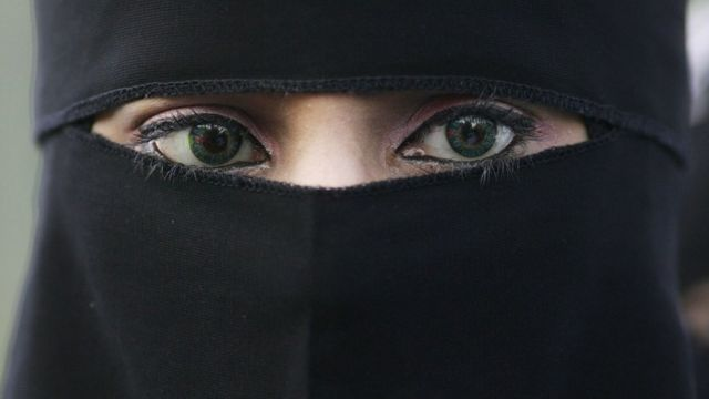 A woman wearing a niqab veil