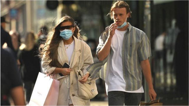 A couple wearing face coverings in Manchester City Centre