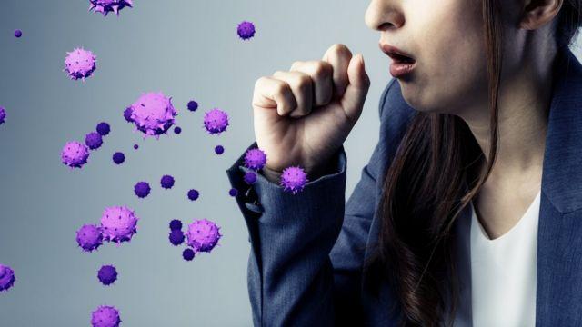 Woman expelling virus through coughing.