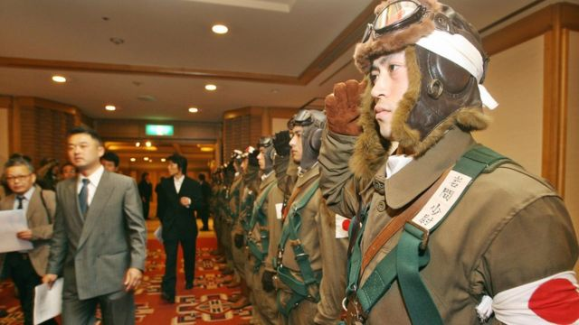 "Men dressed in kamikaze uniform as the then Tokyo Governor held a news conference to promote his movie ""For Those We Love"" in 2006"