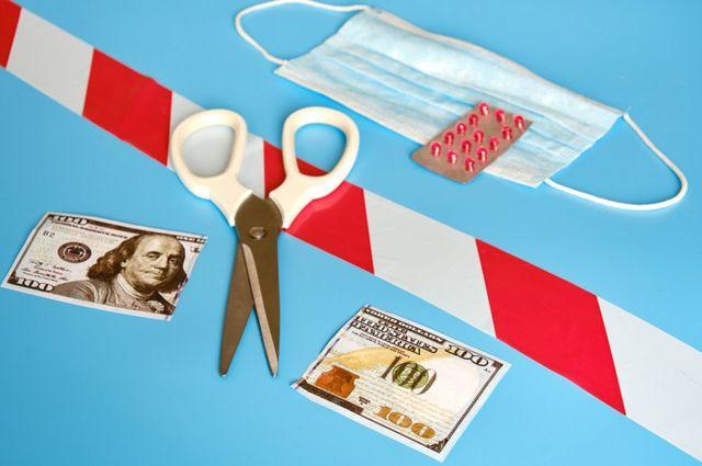 Scissors and a cut $ 100 bill