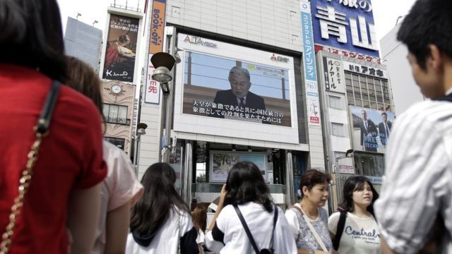 "Pedestrians watch a large screen broadcasting Japanese Emperor Akihito""s video message on his thoughts, in Tokyo, Japan, 08 August 2016."