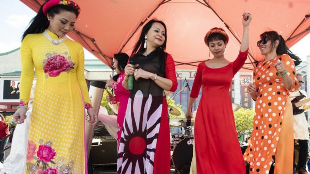 Singers with the band, The Angel Band, sing during the Lunar New Year Celebrations at the Asian Garden Mall in Westminster on Tuesday, February 5, 2019
