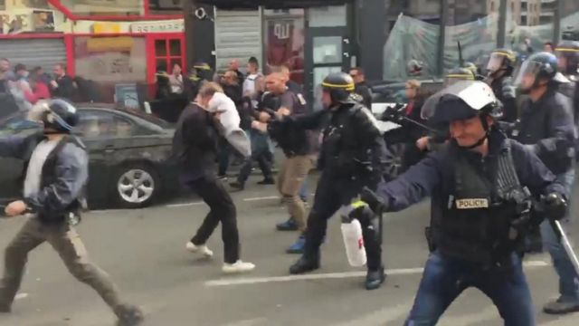 Police in Lille use pepper spray and tear gas on football fans