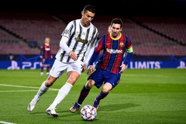 Cristiano Ronaldo (left) and Lionel Messi in action during the 2020/21 UEFA Champions League group stage