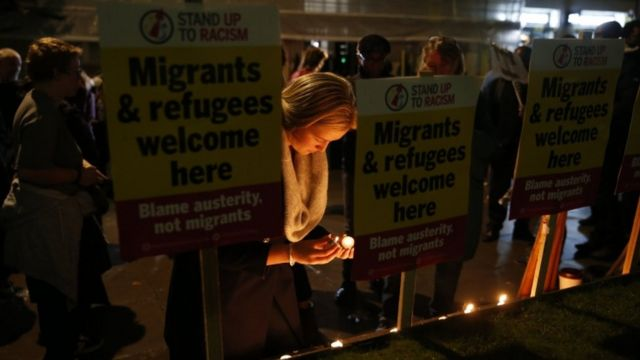 Campaigners attend a vigil outside the Home Office