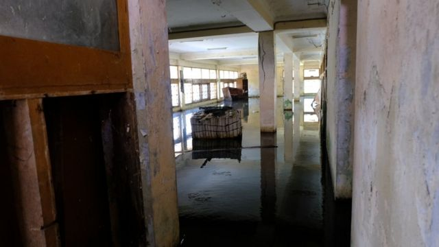 Picture of a flooded ground floor of the abandoned building.