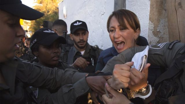 Al Jazeera journalist Givara Budeiri is being taken into custody by Israeli police while she was covering a sitting protest against Israel's decision to evict Palestinian families in Sheikh Jarrah neighbourhood in Jerusalem on 5 June 2021