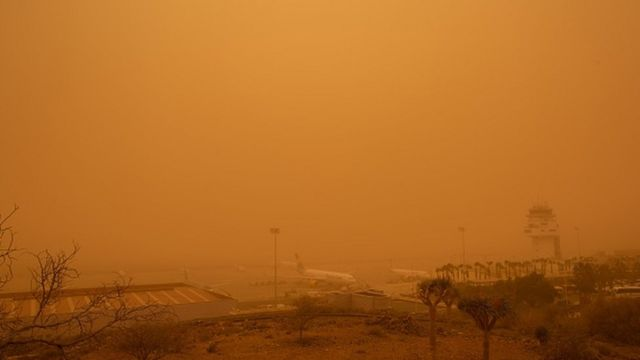 Planes are pictured at Tenerife South Reina Sofia Airport during a sandstorm