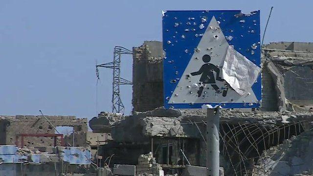 Crossing sign damaged by gunshots