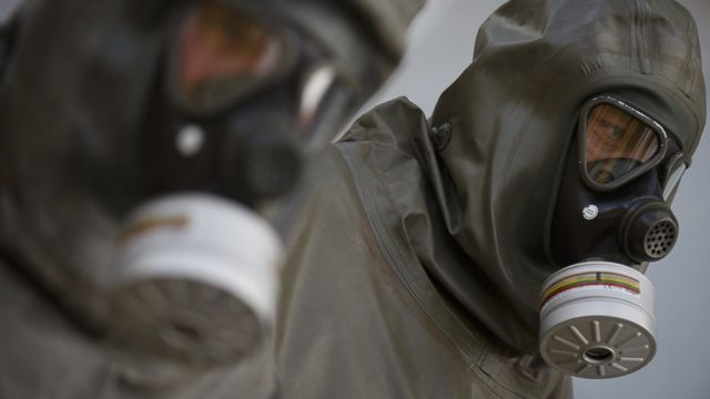 People wearing gas masks and protective gear