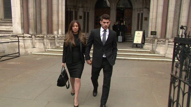 Ched Evans (R) leaving court this
