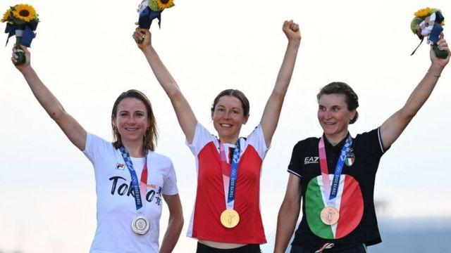 Austria cyclist Anna Kiesenhofer (centre), a scientist and Olympic champion