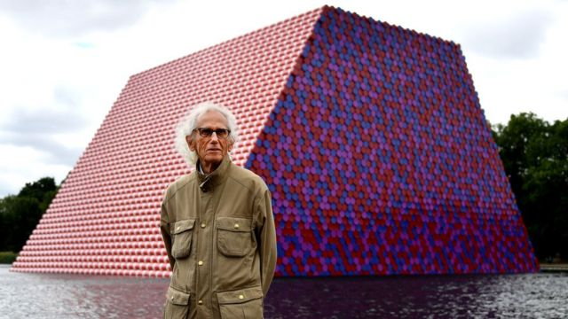 Bulgarian artist Christo stands in front of his artwork Mastaba, built on the Serpentine lake in London, 18 June 2018