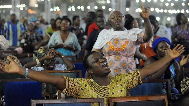 Worshippers pray into the New Year during the crossover watch night church service at the Redemption Camp on Lagos Ibadan highway on January 1, 2014.