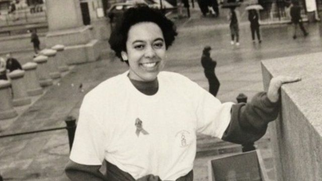 Black and white photo of Michelle Clayford in Trafalgar Square, London