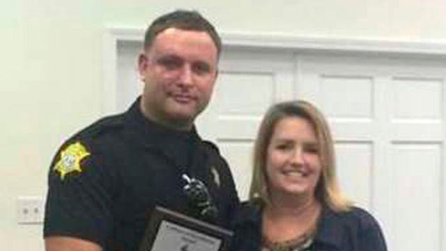 Richland County Sheriff's Department Officer Senior Deputy Ben Fields is pictured with Karen Beaman (R), Principal of Lonnie B Nelson Elementary School, after receiving an excellence award at the school in Columbia, South Carolina, on 2 November 2014