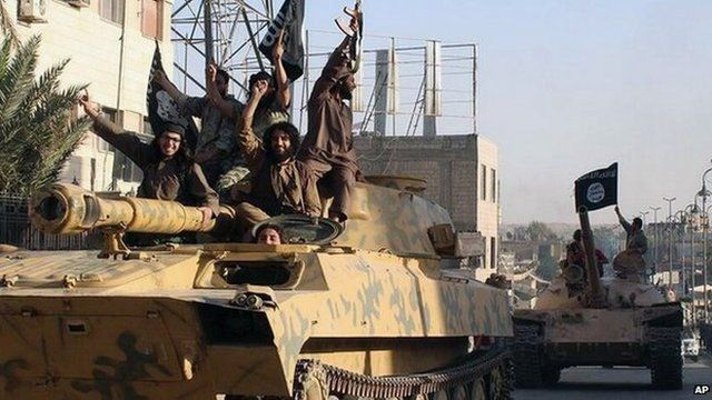 Islamic State fighters drive armoured vehicles through Raqqa, Syria (30 June 2014)