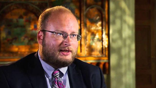 CGTNアメリカのインタビューにロシア大使館経済局長として答えるカルーギン氏