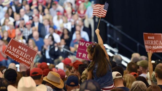 Supporters cheer as US President Donald Trump speaks at a Make America Great Again rally in Phoenix, Arizona