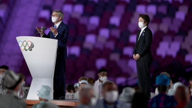 Thomas Bach, IOC President makes a speech as Seiko Hashimoto, Tokyo 2020 President looks on during the Opening Ceremony of the Tokyo 2020 Olympic Games at Olympic Stadium on July 23, 2021 in Tokyo, Japan.