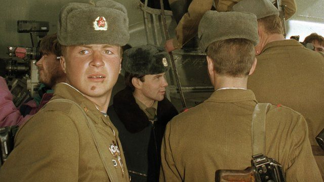 (File photo 1989) Soviet troops climb aboard a transport plane as they prepare to leave Afghanistan