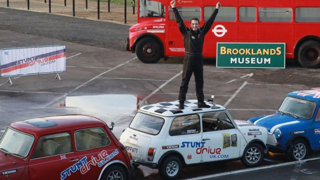 Alastair Moffat from Gloucester celebrates after he achieved the world's tightest parallel park in reverse, in Surrey, 12th November 2015