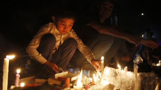 Candles lit during memorial for victims of suicide bomb blast in Kabul. 23 July 2016