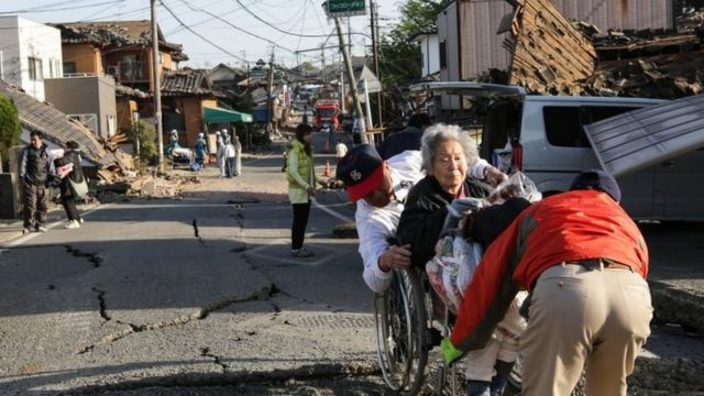 A Kumamoto resident is evacuated from the city. Photo: 16 April 2016