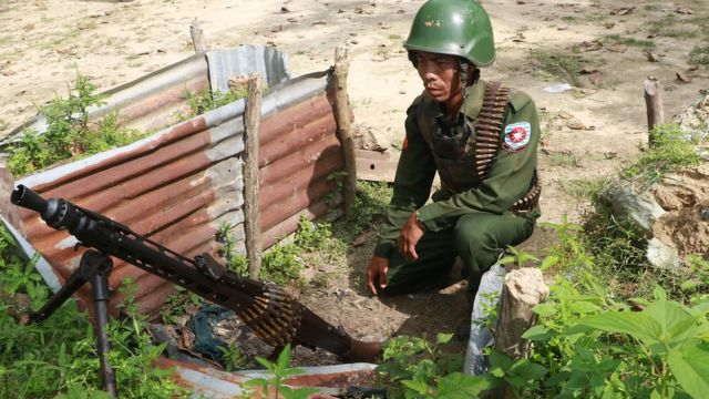 Myanmar soldier manning a machine gun post near the Border Guard Police headquarters in the Kyinkanpyin