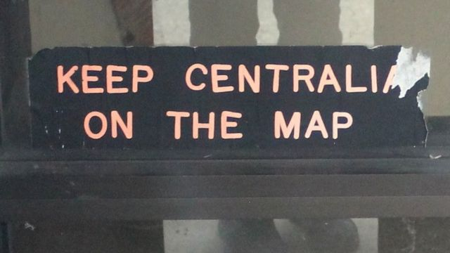 Keep Centralia on the Map: A sticker on the door of Centralia's municipal building, one of its few remaining structures