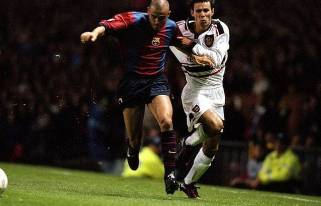 Luis Enrique and Ryan Giggs contest possession in a match in 1998