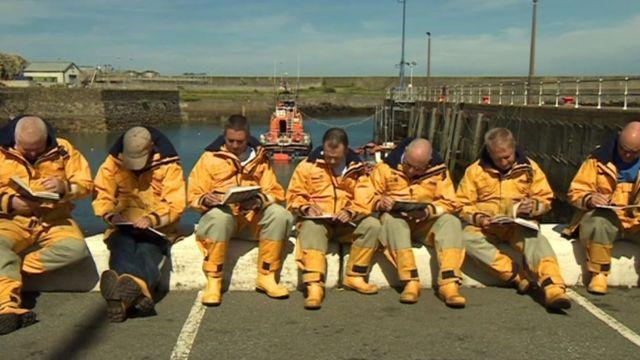 Fishguard lifeboat crew sketching