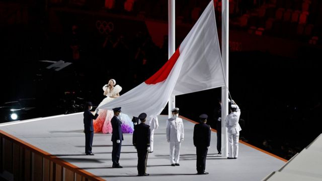The Japan Flag is raised as the national anthem is sung during the Opening Ceremony of the Tokyo 2020 Olympic Games at Olympic Stadium on July 23, 2021 in Tokyo, Japan.